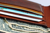 A wallet with some credit cards and cash — Stock Photo