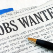 Stock Photo: Searching for job from newspaper