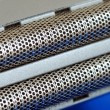 Macro view of metal wire mesh from razor isolated on blue — Stock Photo #3321693