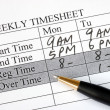 Filling weekly time sheet for payroll — Foto de stock #3321707