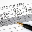 Filling weekly time sheet for payroll — Stockfoto #3321707