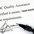 Foto Stock: Sign off quality control document from makeup institution