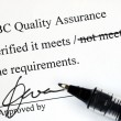 Stok fotoğraf: Sign off quality control document from makeup institution