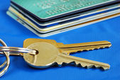 Obtain the credit to buy real estate isolated on blue — Stock Photo