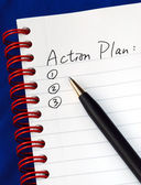 Prepare the action plan in a writing pad isolated on blue — Foto Stock