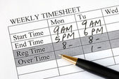Filling the weekly time sheet for payroll — Stock Photo