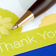 Stock Photo: Write thank you card isolated on blue