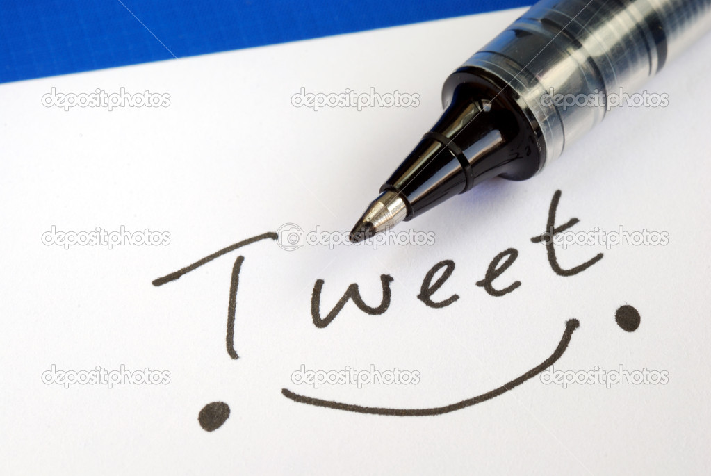 Write the word Tweet and draw a happy smile — Stock Photo #3402112