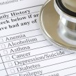 Stock Photo: Fill out the family history section in the medical questionnaire