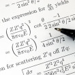 Try to solve some complicated mathematics questions — Stock Photo