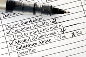 Answer the smoking question in a medical questionnaire — Stock Photo