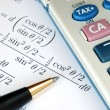 Stock Photo: Solve mathematics question with calculator