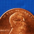 In God We Trust from the penny isolated on blue — Стоковая фотография