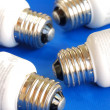 Light bulbs concepts of new ideas and green energy isolated on blue — Photo