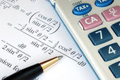 Solve a mathematics question with a calculator — Stock Photo