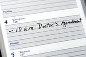 Mark the doctor appointment in the day planner — Stock Photo