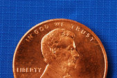 In God We Trust from the penny isolated on blue — Stock Photo