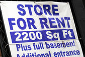 Store for rent sign concepts poor economy — Stock Photo