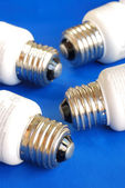 Light bulbs concepts of new ideas and green energy isolated on blue — Stock Photo