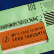 Stock Photo: Send customer survey in business reply envelop