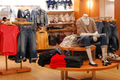 Shopping in a causal clothing store — Stok fotoğraf