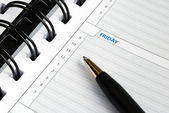 Write some notes on the day planner — Stock Photo