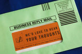 Send the customer survey in the business reply envelop — Stock Photo