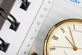 A close up view of the watch and day planner — Stock Photo