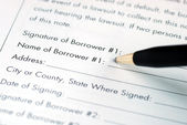 Sign and fill in the name for the borrower — Stock Photo