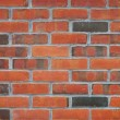 Close up view of a red brick wall — Foto de Stock