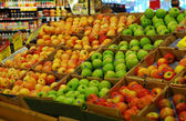 Shopping some fruits in a supermarket — Stock Photo