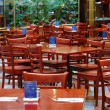Many empty chairs in a restaurant concepts poor business - Stock Photo