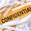 The word Confidential surrounded by some shredded papers — Stock Photo