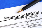 Complete the commercial loan application isolated on blue — Stock Photo
