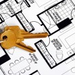 Keys on a floorplan concepts of real estate ownership - Stok fotoraf