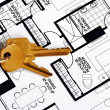 Keys on a floorplan concepts of real estate ownership - Stockfoto
