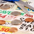 Cut up some coupons to save money — Stock Photo #3614916