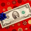 Blue bow on a stack of two dollar bills concepts of gift of money — Lizenzfreies Foto