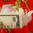 Money in a red gift bag concepts of gift of money — Stock Photo