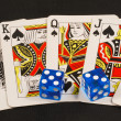 Blue dices on poker cards concepts of gambling or taking a risk — Stock Photo