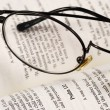 A pair of glasses on a book concepts of knowledge and education — Стоковая фотография