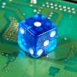 Dice on a computer motherboard concepts of online gambling — 图库照片