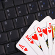 Play cards on a keyboard concepts of online gambling — Photo