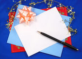 Writing a greeting card to friends and relatives — Stock Photo