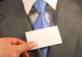 A business man showing a blank card concepts of filling your text here — Stock Photo