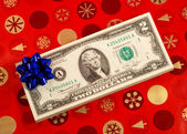Blue bow on a stack of two dollar bills concepts of gift of money — Stock Photo
