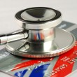 Stethoscope on credit card concepts of checking financial health — Photo #3659597