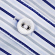Close up view of a button from a shirt — Foto de Stock