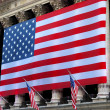 A giant American flag hanging in Wall Street — Stock Photo
