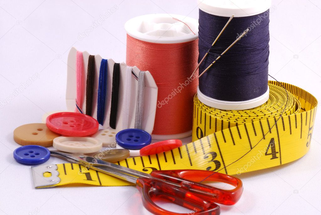 Some sewing tools such as threads, needles, buttons, and scissors — Stock Photo #3659573